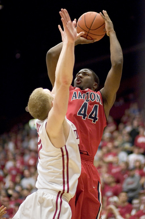 Arizona forward Solomon Hill (44) scores over Washington State forward Abe Lodwick during the second half of an NCAA college basketball game on Thursday, Feb. 16, 2012, in Pullman, Wash. Hill scored 11 points as Arizona won 76-72. (AP Photo/Dean Hare)