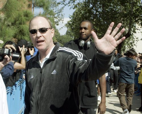 UCLA men's basketball coach Ben Howland waves as the Bruins team marches through the campus in Los Angeles, enroute to the airport and the  NCAA  Final Four tournament, Wednesday, April 2, 2008  (AP Photo/Reed Saxon)