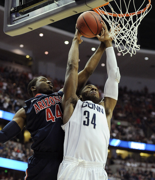 Arizona's Solomon Hill tries to block Connecticut's Alex Oriakhi during the first half of a West regional final game in the NCAA college basketball tournament, Saturday, March 26, 2011, in Anaheim, Calif.  (AP Photo/Mark J. Terrill)