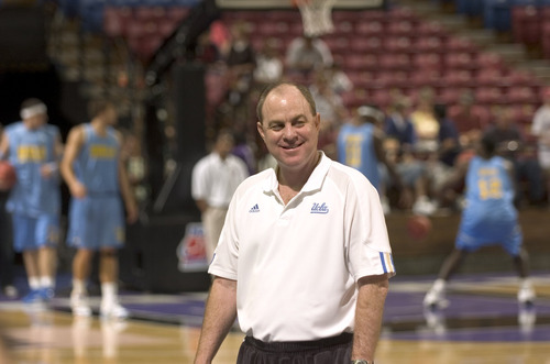 UCLA head coach Ben Howland chats with members of the media at courtside during Wednesday afternoons practice before the 1st round of the Men's NCAA Basketball Championship Western Regional at Arco Arena in Sacramento, California.  Sacramento Bee Photograph by Jos? Luis Villegas March 13, 2007