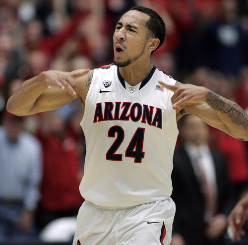 Arizona's Brendon Lavender celebrates one of his 3-pointers against Oregon State during the second half of an NCAA college basketball game at McKale Center in Tucson, Ariz., Thursday, Jan. 12, 2012. (AP Photo/John Miller)