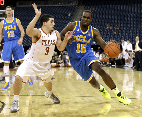 UCLA's Shabazz Muhammad (15) drives toward the basket as Texas' Javan Felix (3) defends during the second half of an NCAA college basketball game at Reliant Stadium Saturday, Dec. 8, 2012, in Houston. UCLA beat Texas 65-63. (AP Photo/David J. Phillip)