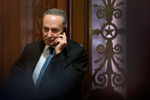"Sen. Charles Schumer, D-N.Y., third ranking in the Senate Democratic leadership, speaks on his cell phone following a closed-door caucus at the Capitol in Washington, Sunday, Dec. 30, 2012 to discuss how to avoid the ""fiscal cliff"" of automatic tax increases and deep spending cuts that could kick in Jan. 1.   (AP Photo/J. Scott Applewhite)"