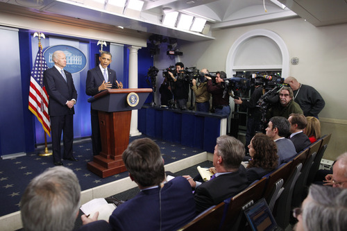 President Barack Obama and Vice President Joe Biden make a statement regarding the passage of the fiscal cliff bill in the Brady Press Briefing Room at the White House in Washington, Wednesday, Jan. 2, 2013. (AP Photo/Charles Dharapak)