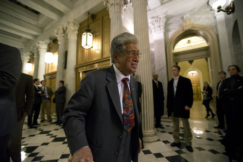 Sen. Daniel Akaka, D-Hawaii, heads to the Senate floor for a vote on the fiscal cliff, on Capitol Hill Tuesday, Jan. 1, 2013 in Washington. The Senate passed legislation early New Year's Day to neutralize a fiscal cliff combination of across-the-board tax increases and spending cuts that kicked in at midnight. (AP Photo/Alex Brandon)