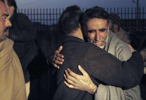 A father of an aid worker, who was killed by gunmen, mourns the death of his daughter at a hospital in Swabi, Pakistan, Tuesday, Jan. 1, 2013. Gunmen in northwest Pakistan killed at least five female teachers and two aid workers on Tuesday in an ambush on a van carrying workers home from their jobs at a community center, officials said. (AP Photo/Mohammad Sajjad)