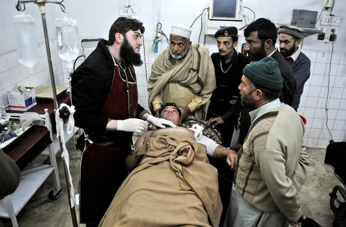 A Pakistani driver who survived an attack on a van which was targeted by gunmen in Swabi , lies at the Lady Reading Hospital bed after being admitted for treatment, in Peshawar, Pakistan, Tuesday, Jan. 1, 2013. Gunmen killed several female teachers and two other people on Tuesday in an ambush on a van carrying workers home from their jobs at a community center in northwest Pakistan, officials said. The attack was a reminder of the risks faced by educators and aid workers, especially women, in an area where Islamic militants often target women and girls trying to get an education or female teachers working with both genders. (AP Photo/Mohammad Sajjad)