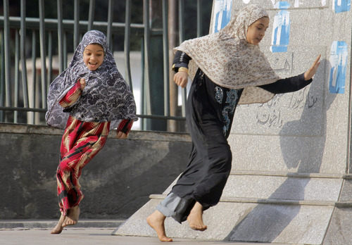 The New Year's day holiday brings Egyptian children out to play on the street in the affluent neighborhood of Zamalek, Cairo, Egypt, Tuesday, Jan. 1, 2013. (AP Photo/Amr Nabil)