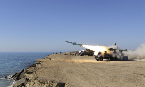 """A Ghader missile is launched from the area near the Iranian port of Jask port on the shore of the Oman Sea during an Iranian navy drill, Tuesday, Jan. 1, 2013. Iran says it has tested advanced anti-ship missiles in the final day of a naval drill near the strategic Strait of Hormuz, the passageway for one-fifth of the world's oil supply. State TV says """"Ghader"""", or """"Capable"""", a missile with a range of 200 kilometers (120 miles), was among the weapons used Tuesday. It says the weapon can destroy warships. (AP Photo/Jamejam Online, Azin Haghighi)"""