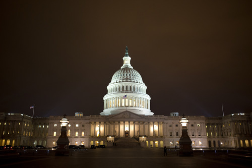 "The lights of the U.S. Capitol remain lit into the night as the House continues to work on the ""fiscal cliff"" legislation proposed by the Senate, in Washington, on Tuesday, Jan. 1, 2013. (AP Photo/Jacquelyn Martin)"