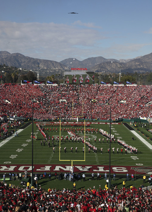 A B-2 stealth bomber passes over the stadium during pregame festivities for Rose Bowl NCAA college football game between Stanford and Wisconsin on Tuesday, Jan. 1, 2013, in Pasadena, Calif. (AP Photo/Richard Vogel)