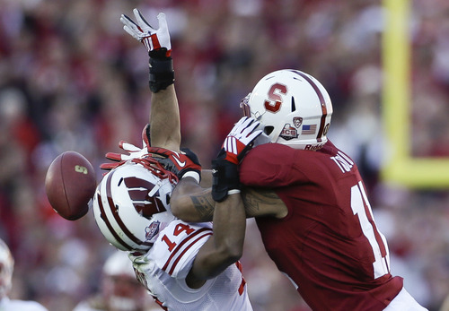 A pass intended for Stanford tight end Levine Toilolo is blocked by Wisconsin defensive back Nate Hammon during the first half at the Rose Bowl NCAA college football game Tuesday, Jan. 1, 2013, in Pasadena, Calif. (AP Photo/Lenny Ignelzi)