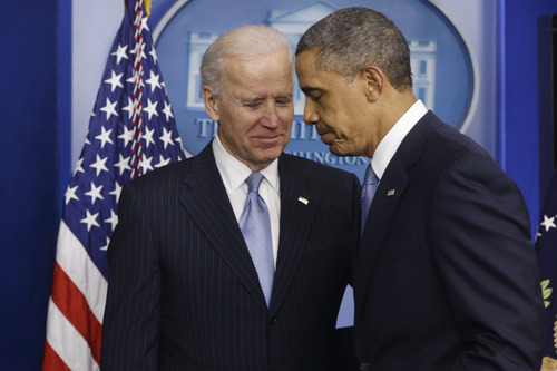 President Barack Obama and Vice President Joe Biden walk away from the podium after Obama made a statement regarding the passage of the fiscal cliff bill in the Brady Press Briefing Room at the White House in Washington, Tuesday, Jan. 1, 2013. (AP Photo/Charles Dharapak)
