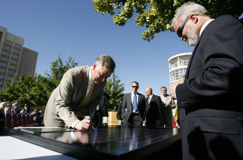 Leah Hogsten  |  Tribune file photo Salt Lake County Mayor Peter Corroon and other partners from NexGen energy and Bella energy sign a solar panel, one of 11,000 panels that will be placed atop the convention center. Salt Lake County announced plans to place a 600,000 square-foot system of solar panels atop the Salt Palace Convention Center in Salt Lake City on Wednesday, September 1, 2010. The project is part private and public partnership led by Salt Lake County Mayor Peter Corroon's goal of using renewable energy sources on county-owned facilities.