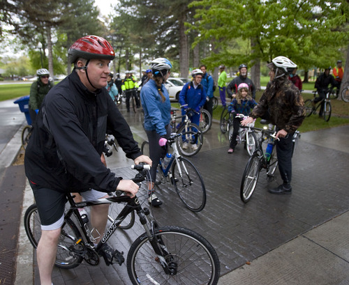 Al Hartmann  |  Tribune file photo Salt Lake County Mayor Peter Corroon, left, and Salt Lake City Mayor Ralph Becker, right, gather a group of  bike riders to ride from Liberty Park to Salt Lake County Government Center and the City County Building for Bike To Work Day on Tuesday May 17, 2011.