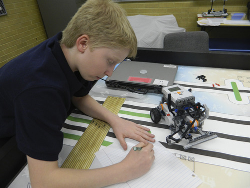 Carol Lindsay  |  Special to The Tribune A student from Layton Junior High School's robotics club works on the First Lego League challenge.