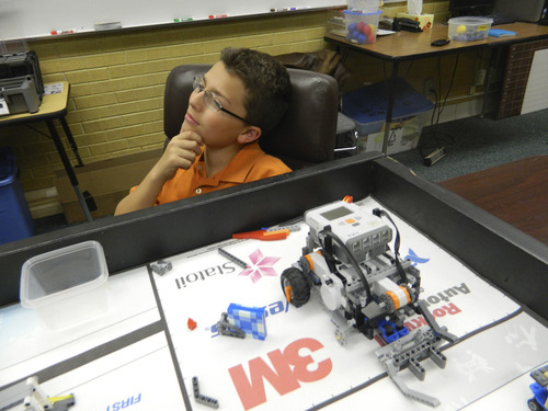 Carol Lindsay  |  Special to The Tribune A student from Layton Junior High School's robotics club thinks about his project for the First Lego League challenge.