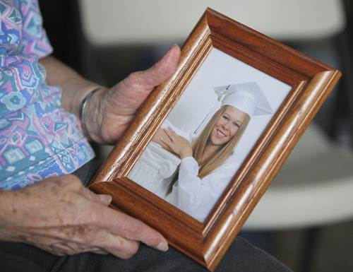 Lennie Mahler  |  The Salt Lake Tribune Laraine Reid holds a graduation photo of her granddaughter, Shantelle Reid, at her home in West Jordan on Tuesday, April 10, 2012. Shantelle was shot to death by 31-year-old Ryan Robinson in Murray on Monday, April 9.