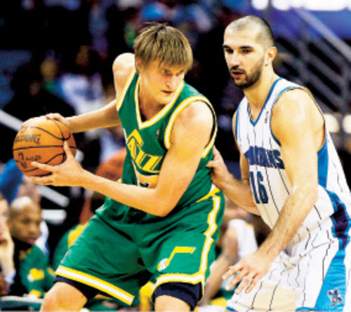 Utah Jazz forward Andrei Kirilenko, left, of Russia, keeps the ball away from New Orleans Hornets forward Peja Stojakovic, of Serbia, during the second half of an NBA basketball game in New Orleans, Wednesday, Feb. 17, 2010. Utah defeated New Orleans 98-90. (AP Photo/Patrick Semansky)
