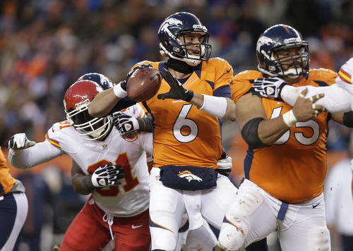 Denver Broncos quarterback Brock Osweiler (6) sets to throw a pass in the fourth quarter of an NFL football game against the Kansas City Chiefs, Sunday, Dec. 30, 2012, in Denver. The Broncos won 38-3.(AP Photo/Joe Mahoney)
