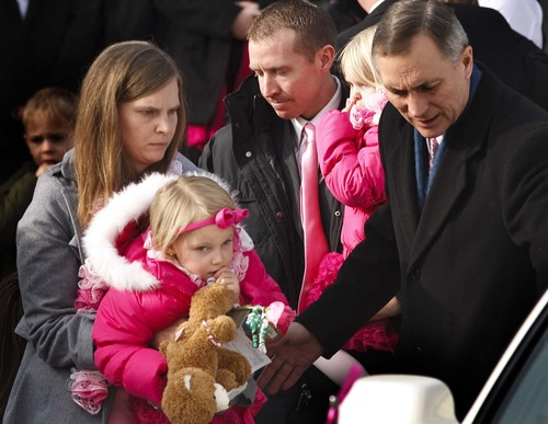 Leah Hogsten  |  The Salt Lake Tribune Robbie Parker carries daughter Madeline, 4, and Alissa Parker carries Samantha, 3, from the funeral service for their oldest daughter, Emilie, Saturday, Dec. 22, 2012, in Ogden.