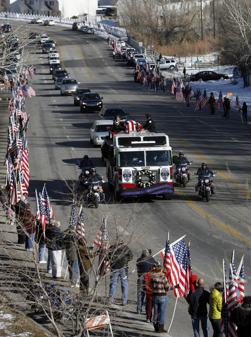 Francisco Kjolseth  |  The Salt Lake Tribune Thousands pay their respects to slain Ogden police Officer Jared Francom along the funeral procession route in Ogden on Wednesday, Jan. 11, 2012.