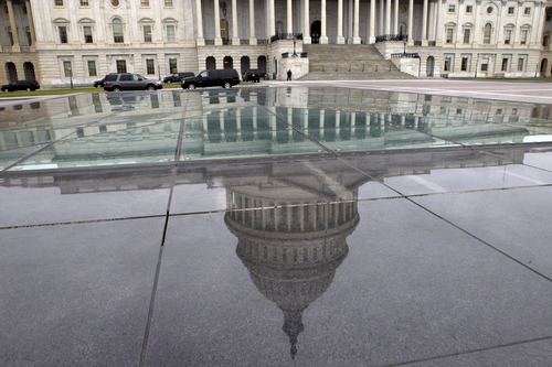 FILE - In this Tuesday, Jan. 1, 2013, file photo, the dome of the Capitol is reflected in a skylight of the Capitol Visitor's Center in Washington. By delaying hard choices on spending, the fiscal cliff deal guaranteed more confrontation and uncertainty this year, especially when Congress must vote later this winter to raise the government's borrowing limit. That's likely to keep businesses cautious about hiring and investing. (AP Photo/Jacquelyn Martin, File)