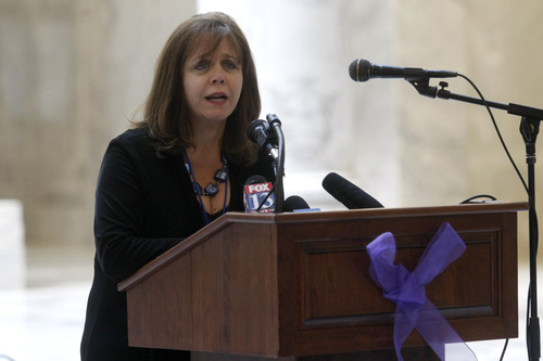 Chris Detrick  |  The Salt Lake Tribune Peg Coleman, executive director for the Utah Domestic Violence Council, speaks during a ceremony by the Utah Domestic Violence Council in the Utah State Capitol rotunda Wednesday January 2, 2013.  They were remembering all of the victims of domestic violence-related deaths in the past year.