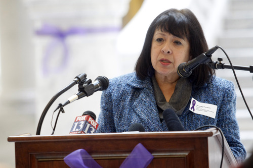 Chris Detrick  |  The Salt Lake Tribune Domestic abuse survivor Brandy Farmer speaks during a ceremony by the Utah Domestic Violence Council in the Utah State Capitol rotunda Wednesday January 2, 2013.  They were remembering all of the victims of domestic violence-related deaths in the past year.