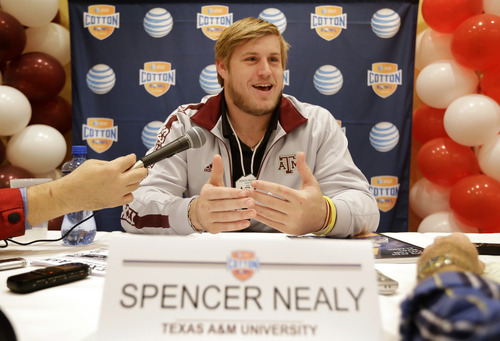 Texas A&M's Spencer Nealy responds to questions during an NCAA Cotton Bowl football game press conference Monday, Dec. 31, 2012, in Irving, Texas. Texas A&M will play Oklahoma in the Cotton Bowl on Friday night at Cowboys Stadium. (AP Photo/Tony Gutierrez)