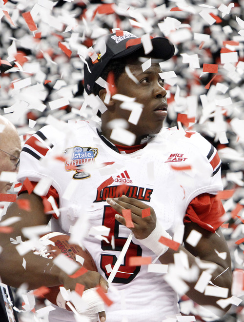 Louisville quarterback Teddy Bridgewater (5) watches the pageantry unfold after a 33-23 win over Florida in the Sugar Bowl NCAA college football game Wednesday, Jan. 2, 2013, in New Orleans. (AP Photo/Butch Dill)