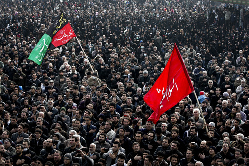 Iranian mourners beat their chests, in a ceremony commemorating Arbaeen, the final day of the annual 40-day mourning period for the seventh century martyrdom of Imam Hussein, the grandson of Prophet Muhammad, in Tehran, Iran, Thursday, Jan. 3, 2012. (AP Photo/Vahid Salemi)