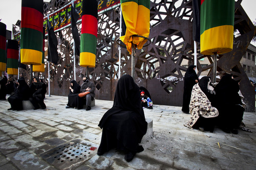 Iranian mourners attend a ceremony commemorating Arbaeen, the final day of the annual 40-day mourning period for the seventh century martyrdom of Imam Hussein, the grandson of Prophet Muhammad, in Tehran, Iran, Thursday, Jan. 3, 2012. (AP Photo/Vahid Salemi)