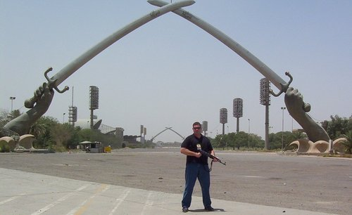 Patrick Kelly, a Salt Lake City resident, in front of the crossed swords monument at the Green Zone in Baghdad, Iraq. Courtesy Pat Kelly