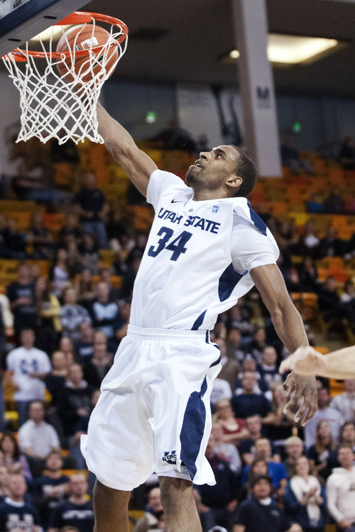 Utah State's Kyisean Reed dunks against Seattle during the first half of their NCAA college basketball game, Thursday, Jan. 3, 2013, in Logan, Utah. (AP Photo/The Herald Journal, Jennifer Meyers)
