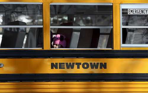 A child sits on a Newtown bus leaving the new Sandy Hook Elementary School on the first day of classes in Monroe, Conn., Thursday, Jan. 3, 2013. Classes resumed Thursday for the students of the school where a gunman last month burst in and killed 20 children and six adults before killing himself. It was the second largest school shooting in the U.S. history. With their school still being treated as a crime scene, the more than 400 students of Sandy Hook Elementary School attended classes at the neighboring town's Chalk School. AP Photo/Jessica Hill)