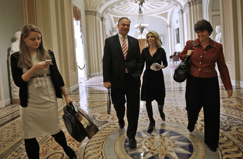 Sen-elect Tim Kaine, D-Va., center, and his wife Anne Bright Holton, right, arrive for the freshman Senators luncheon on Capitol Hill in Washington, Tuesday, Nov. 13, 2012. (AP Photo/Pablo Martinez Monsivais)