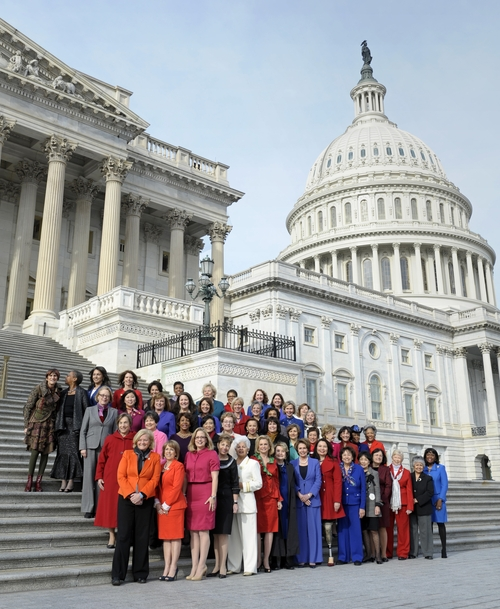 House Minority Leader Nancy Pelosi of Calif., front row, center, poses with female House members on the steps of the House on Capitol Hill in Washington, Thursday, Jan. 3, 2013, prior to the officially opening of the 113th Congress. (AP Photo/Cliff Owen)
