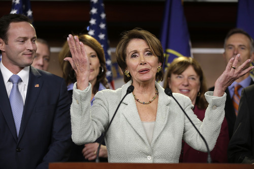 House Minority Leader Nancy Pelosi of Calif. gestures during a news conference on Capitol Hill in Washington, Tuesday, Nov. 13, 2102,  with newly elected Democratic House members. At left is Rep.-elect Patrick Murphy, D-Fla. (AP Photo/Pablo Martinez Monsivais)