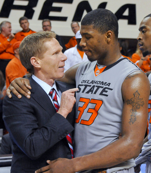 Gonzaga coach Mark Few, left, talks with Oklahoma State guard Marcus Smart following an NCAA college basketball game in Stillwater, Okla., Monday, Dec. 31, 2012. Smart led Oklahoma State with 23 points but Gonzaga won 69-68. (AP Photo/Brody Schmidt)