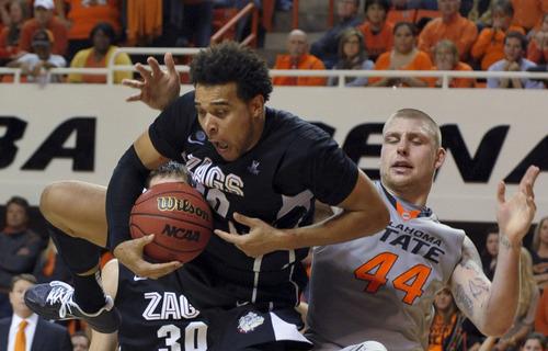 Gonzaga forward Elias Harris jumps in front of Oklahoma State center Philip Jurick, right, to rebound a missed free throw during the final minute of an NCAA college basketball game in Stillwater, Okla., Monday, Dec. 31, 2012. The Harris rebound helped Gonzaga to maintain its lead over Oklahoma State and win 69-68. (AP Photo/Brody Schmidt)