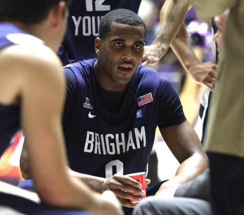 Rick Egan  | The Salt Lake Tribune   Brigham Young Cougars forward Brandon Davies (0) takes a breather during a time out, Davies had 18 points in the first half, in basketball action, BYU vs. Weber State, in Ogden, Saturday, December 15, 2012.