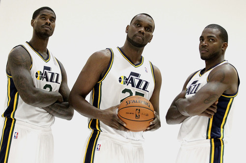 Utah Jazz's Marvin Williams, left, Al Jefferson and Paul Milsap, right, pose for a photograph during the NBA basketball team's media day, Monday, Oct. 1, 2012, in Salt Lake City. (AP Photo/Rick Bowmer)
