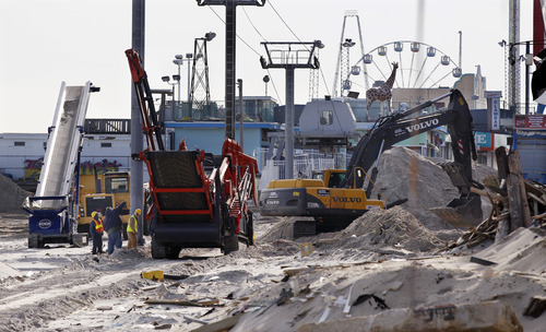 Crews work work to replace the Superstorm Sandy destroyed boardwalk in Seaside Heights, N.J., Thursday, Jan. 3, 2013.   Under intense pressure from angry Republicans, House Speaker John Boehner has agreed to a vote this week on aid for Superstorm Sandy recovery.  (AP Photo/Mel Evans)