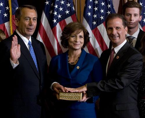 Scott Sommerdorf  |  The Salt Lake Tribune Congressman Chris Stewart, R-Utah, right, poses during the ceremonial swearing-in Thursday with House Speaker John Boehner R-Ohio. Stewart's wife, Evie, stands between them.