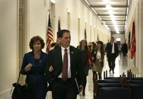 Scott Sommerdorf  |  The Salt Lake Tribune Congressman-elect Chris Stewart, R-Utah, his wife, Evie, and his family walk through the hallways of the Capitol building on their way to Stewart's swearing-in, Thursday, Jan. 3, 2013.