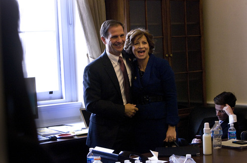 Scott Sommerdorf  |  The Salt Lake Tribune Congressman-elect Chris Stewart, R-Utah, and his wife, Evie, behind his new desk in the Capitol building prior to Stewart's swearing-in, Thursday, Jan. 3, 2013.