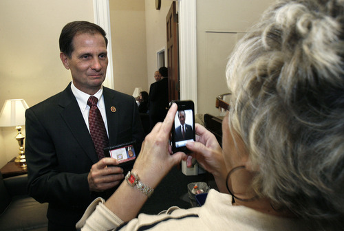 Scott Sommerdorf  |  The Salt Lake Tribune Congressman-elect Chris Stewart, R-Utah, stops to pose for a photo by supporter Connie Smith in his Capitol office prior to Stewart's swearing-in, Thursday, Jan. 3, 2013.