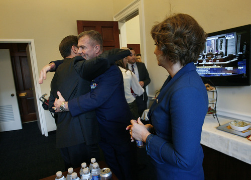 Scott Sommerdorf  |  The Salt Lake Tribune Congressman Chris Stewart, R-Utah, hugs an old U.S. Air Force friend, Maj. Chris Walsh, in Stewart's office with Stewart's wife, Evie, at right, Thursday, January 3, 2013.