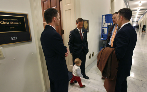 Scott Sommerdorf  |  The Salt Lake Tribune While visting with supporters in the hallway outside his office, Congressman Chris Stewart, R-Utah, looks down to see his 16-month-old grandson, Chase, wandering out to see him, Thursday, January 3, 2013.
